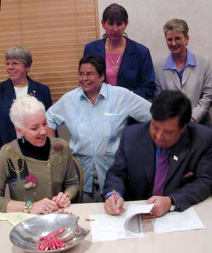 Governor Richardson signs an executive order extending benefits to domestic partners of state employees